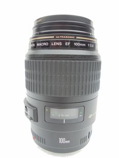A Canon Macro lens EF 100 MM 1:2.8 USM production year unknown.