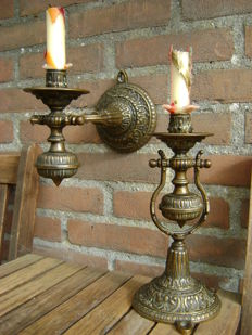 Set of unique and decorative tilting candlesticks.