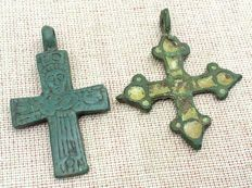 Two medieval crosses, Medieval bronze cruciform (double cross) pendant with pseudo depiction of Christ, and a cross with enamels 40x23mm 37x32mm