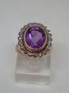 Gold ring with amethyst and antique rose-cut diamonds.