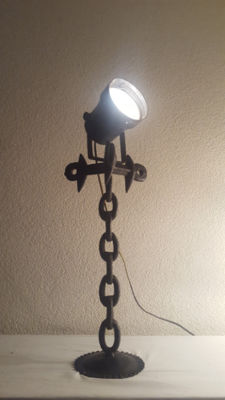 Industrial floor - signal lamp on heavy cast-iron ship chain tripod