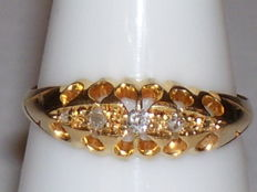 18 karat gold ring with five diamonds. The ring dates from 1918.