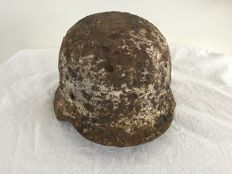 German soil find helmet-M-40-WW2. Winter camouflage