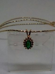 18 kt gold necklace with emerald and diamond pendant.