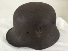 German helmet M-18. WW2 archaeological find. Remainders decal.