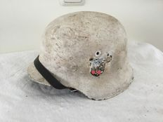 German helmet M-42 WW2. Winter camouflage