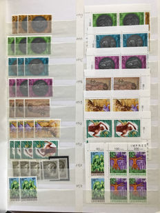 Luxembourg 1986/1999 - Batch with stamps and series with blocks of four, in a stock book.