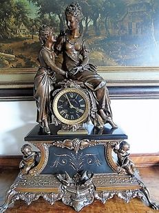 Large Zamak and black marble Romantic dual statue pendulum clock – France, second period 1800.
