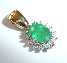 Clip pendant made of 14kt/585 gold/white gold with natural emerald + diamonds approx. 1.3ct in total.
