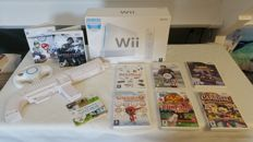Complete Wii in the original boxing with 2x wii mote, 2x nun chunk and  9 great games