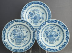 Series of three identical plates decorated with royally filled blossom baskets - China - around 1750