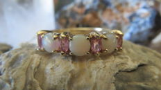 Gold ring with natural opals and pink sapphires.