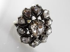 Antique, large ring with large rose cut diamonds set in silver