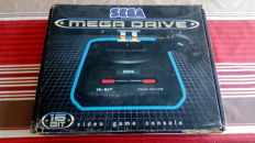Console Sega Megadrive II boxed with 2 controllers and 2 games.