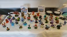 Lot of 45 Skylanders with two portals!!! With the games for Wii: Skylanders Giants and Spyro's Adventure.