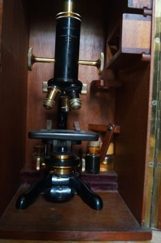 "A black lacquer and brass ""Service"" W. Watson and Sons monocular microscope"