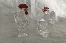 Swarovski - Rooster and Hen with red crest.
