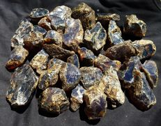 Lot of raw blue/red amber from Sumatra - 1 kg