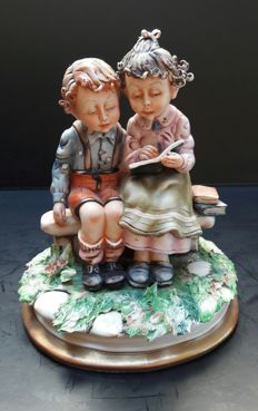 A couple of different Milio Capodimonte sculptures