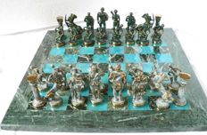 "Bronze chess of  ""Greek mythology"". Marble and blue quartz board."