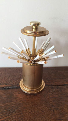 A vintage gold-coloured cigarette dispenser for 25 cigarettes; 1950s/1960s