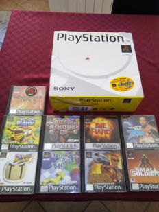 PlayStation one SPCH - 5502 Boxed - with 9 original games.