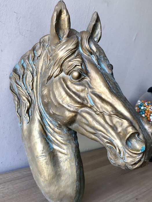 Very large handmade sculpture of a horse's head