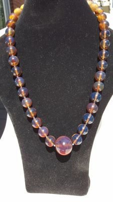 Blue Sumatra Amber fluorescent beaded necklace, untreated, weight 82.2 grams