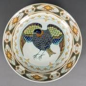 Rozenburg Den Haag, earthenware plate with multicoloured bird decor