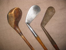 2 Golf Irons and 1 Wood 2
