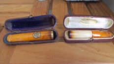 2 French antique cigar holders: 1. Amber, with 14kt gold 2: amber and meerschaum - ca. 1880