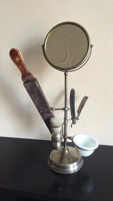A beautiful chrome-plated shaving mirror on stand with accessories.