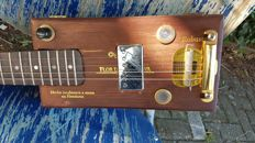 Cigar box guitar: Guitar made of a cigar box