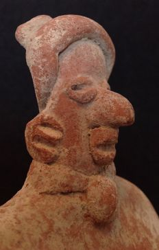Pre-Columbian Colima seated figure wearing a poncho - 14 cm