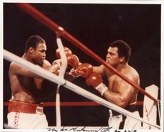 Muhammad Ali - 8 x 10 hand signed and dedicated photograph facing Larry Holmes