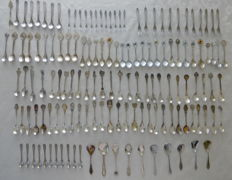 Collection of 140 silver plated and metal spoons and forks