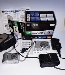 Fuji Finepix F47 and Nikon Coolpix 4600 digital cameras. Fuji camera complete in bos