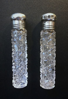 Two small crystal perfume bottles with glass and silver closing, 2nd half of the 19th century