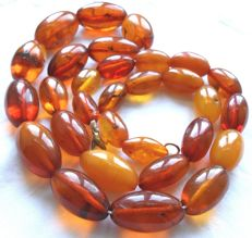 Antique necklace made of 100% natural orange honey amber – 56.34 g