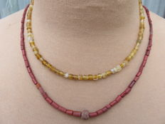 Late medieval necklaces with yellow glass and stone beads - 41 cm and 52 cm. (2)