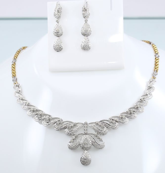 IGI Certified 6.32 ct diamond necklace with matching earrings and chain