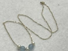 18 kt (750/1000) gold - gold necklace with aquamarines and cultured pearls - length 44cm - No reserve.
