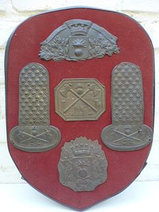 Display with French Sapeurs Pompiers emblems and shoulder pieces.