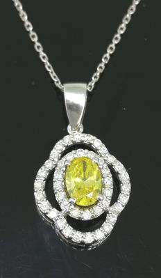 18 kt white gold pendant fancy intense vivid yellow colour diamond & 42 diamonds of 1.01 ct in total
