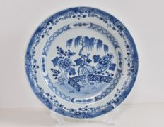 Porcelain plate with blue-white landscape – China – 18th century