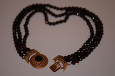 Necklace with 14k gold clasp and 3 strands of garnets