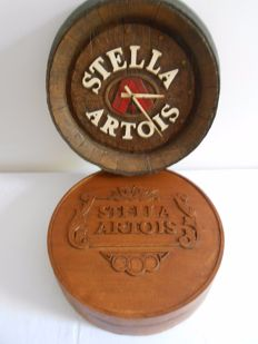 STELLA ARTOIS beer - 1 round veneer wooden box and a wall clock after the model of a barrel - 1970s.