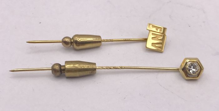 2 pieces of gold pins.