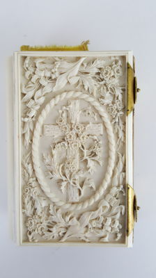 A Victorian carved ivory book cover, covering the Holy Bible, with brass hinge lock - England - second half 19th century