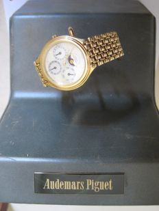 Audemars Piguet gold watch, mother of pearl dial